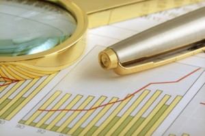 Some graphs and sheets, all in gold color, illustration of a work of a financial analyst